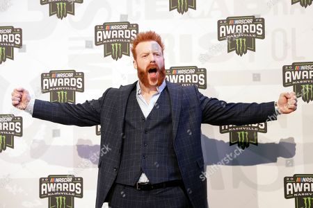 Professional wrestler and actor Sheamus arrives at the NASCAR Cup Series Awards, in Nashville, Tenn