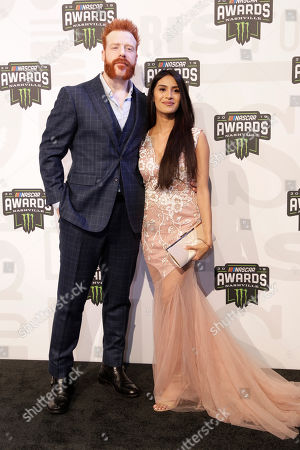 Professional wrestler and actor Sheamus, left, and Isabella Revilla arrive at the NASCAR Cup Series Awards, in Nashville, Tenn