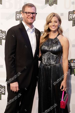 Dale Earnhardt Jr. and Amy Reimann arrive at the NASCAR Cup Series Awards, in Nashville, Tenn