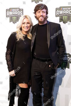 Country music artist Chris Janson, right, and his wife, Kelly Lynn, arrive at the NASCAR Cup Series Awards, in Nashville, Tenn