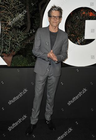 Kevin Bacon arrives at GQ's Men of the Year Celebration, in West Hollywood, Calif