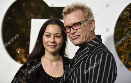 China Chow, Billy Idol. China Chow, left, and Billy Idol arrive at GQ's Men of the Year Celebration, in West Hollywood, Calif