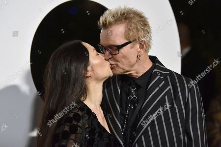 China Chow, Billy Idol. China Chow, left, and Billy Idol kiss as they arrive at GQ's Men of the Year Celebration, in West Hollywood, Calif