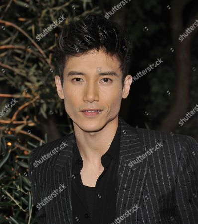 Manny Jacinto arrives at GQ's Men of the Year Celebration, in West Hollywood, Calif