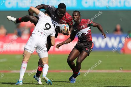 Ollie Lindsay-Hague, Jacob Ojee. England's Ollie Lindsay-Hague tackles Kenya's Jacob Ojee during a match of the Emirates Airline Rugby Sevens in Dubai, United Arab Emirates, Friday, Dec.6, 2019