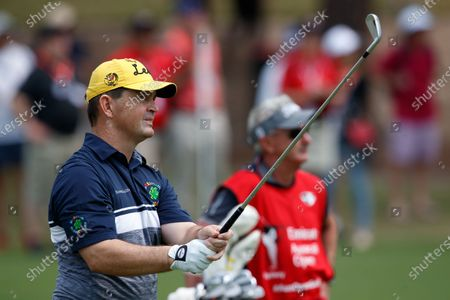 Stock Photo of Greg Chalmers (AUS) hits the ball