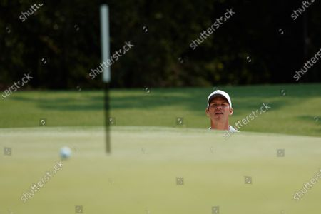 Paul Casey (ENG) hits out of the bunker