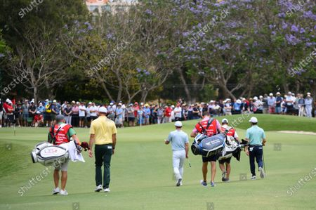 Paul Casey (ENG), Louis Oosthuizen (RSA) and Jamie Arnold (AUS) walk to the 2nd green