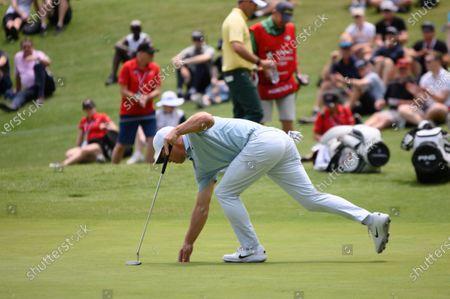 Paul Casey (ENG) picks up his ball