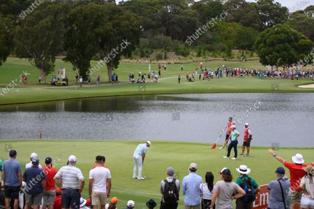 Paul Casey (ENG) putts on the 3rd green