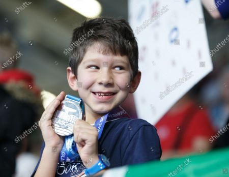 A young spectator receives the silver medal Florent Manaudou of France won in the Men's 50m Freestyle Final at the LEN European Short Course Swimming Championships 2019 in Glasgow, Scotland, Britain, 06 December 2019.