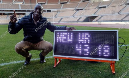 Former US sprinter Michael Johnson poses for the photographer as he marks the 20th anniversary of 400m World record set during Seville Athletics World Championship at La Cartuja Stadium, in Seville, southern Spain, 06 December 2019. The four-time olympic champion and eight-time world champion visited the stadium to mark the anniversary of the record (43.18 seconds) that was kept until 2016 Rio Olympic Games.