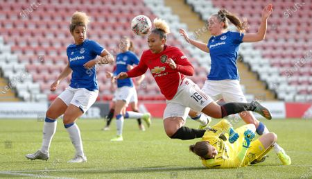 Lauren James of Manchester United Women runs in for the ball but is tackled to the ground by goalkeeper Tinja-Riikka Korpela of Everton Women