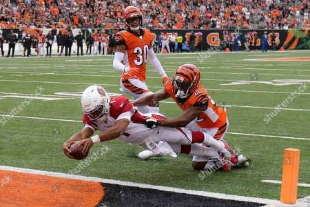 Arizona Cardinals quarterback Kyler Murray (1) leaps in for a touchdown against Cincinnati Bengals cornerback William Jackson (22) in the first half of an NFL football game, in Cincinnati. Murray went to Arizona with the top pick a year after the Cardinals used a first-rounder on Josh Rosen and has lived up to the billing. Murray has thrown for 2,866 yards while starting every game, has thrown for 14 TDs compared to only six interceptions, and has rushed for 446 yards and four scores