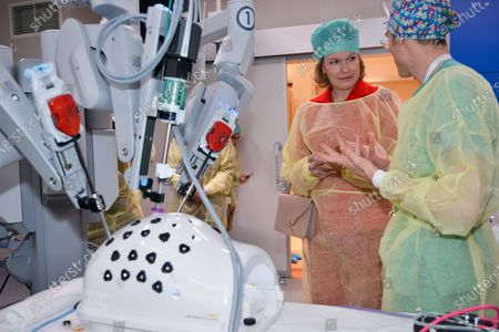 Stock Photo of Queen Mathilde in the new technology operating room equipped with a robot for remote operation