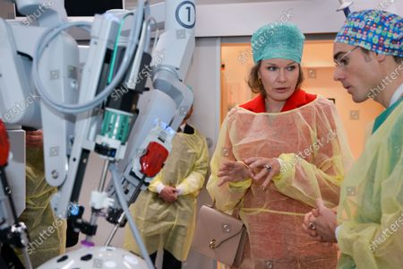 Stock Picture of Queen Mathilde in the new technology operating room equipped with a robot for remote operation