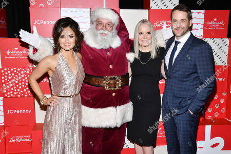 Stock Image of Danica McKellar, Niall Matter, Michelle Vicary. Co-stars Danica McKellar, left, and Niall Matter, right, appear on the red carpet with Hallmark Channel executive vice president Michelle Vicary and Santa at the world premiere of Christmas at Dollywood hosted by JCPenney and Hallmark Channel at Village East Cinema, in New York. Christmas at Dollywood debuts on the Hallmark Channel Sunday, December 8 (8p.m. ET/PT, 7c