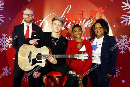 Carson Lueders, second left, is joined by, from left, Macy's Herald Square store manager Chris Glass, Make-A-Wish kid Christian, and Make-A-Wish representative Anika Daughtry as he helps Macy's celebrate National Believe Day at Macy's Herald Square, in New York