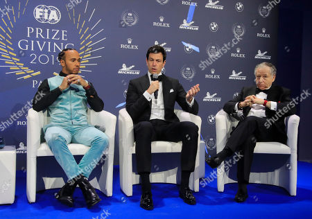 Formula One Champion Lewis Hamilton of Britain, left, Mercedes team principal Toto Wolff, center, and FIA President Jean Todt attend the 2019 FIA Champions' Press Conference in Paris
