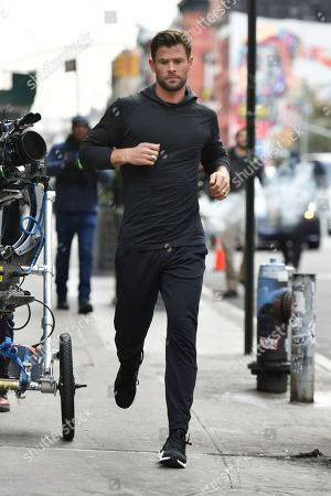 Chris Hemsworth filming a commercial on the streets in New York City.