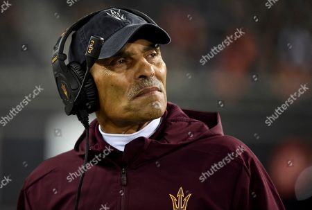 """Shows Arizona State coach Herm Edwards watching from the sideline during the second half of the team's NCAA college football game against Oregon State in Corvallis, Ore. In 2003, the NFL had three minority head coaches: future Pro Football Hall of Famer Tony Dungy, Edwards and Marvin Lewis. In the 12 previous seasons, there had been six. Total. Considering that the majority of the players in the league 16 years ago were minorities, that imbalance was enormous. And disturbing. And, frankly, it was unfair. Paul Tagliabue, then the NFL commissioner, put together a committee that established the """"Rooney Rule,"""" which requires all teams with coaching and front office vacancies to interview minority candidates. The rule, long overdue, was named for Dan Rooney, then president of the Pittsburgh Steelers and the overseer of that committee"""