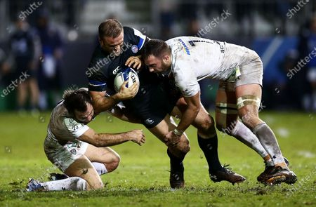 Jamie Roberts of Bath is tackled by Alexandre Lapandry of Clermont Auvergne.
