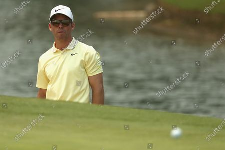 Paul Casey of Britain looks on after hitting a ball from the bunker during the round three of The Australian Open golf championship at The Australian Golf Club in Sydney, Australia, 07 December 2019.