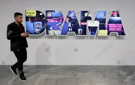 A patron walks by the work 'Drama' by US artist Doug Aitken during Art Basel in Miami, Florida, USA, 06 December 2019. Art Basel represents over 250 art galleries onsite at the Miami Beach Convention Center and is considered one of the world's largest art festivals with art events throughout the city.