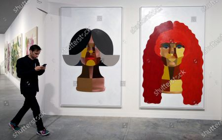 A patron walks by 'Style Variations' by US artist Derrick Adams during Art Basel in Miami, Florida, USA, 06 December 2019. Art Basel represents over 250 art galleries onsite at the Miami Beach Convention Center and is considered one of the world's largest art festivals with art events throughout the city.