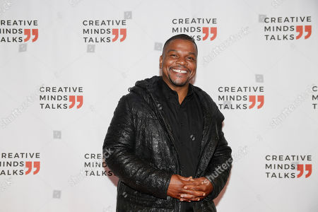 Kehinde Wiley poses for a portrait during Miami Art week, in Miami Beach, Fla