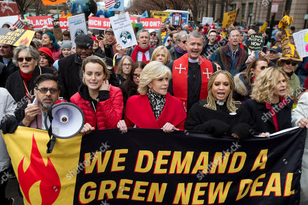 "Actress and activist Jane Fonda accompanied actresses Taylor Schilling second from left, and Kyra Sedgwick, right, along with others, march in downtown during the ""Fire Drill Fridays"" protest, calling on Congress for action to address climate change, in Washington. A half-century after throwing her attention-getting celebrity status into Vietnam War protests, Fonda is now doing the same in a U.S. climate movement where the average age is 18"