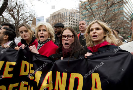 "Actress and activist Jane Fonda accompanied actresses Taylor Schilling left, Maura Tierney and Kyra Sedgwick, right, along with others, march in downtown during the ""Fire Drill Fridays"" protest, calling on Congress for action to address climate change, in Washington. A half-century after throwing her attention-getting celebrity status into Vietnam War protests, Fonda is now doing the same in a U.S. climate movement where the average age is 18"