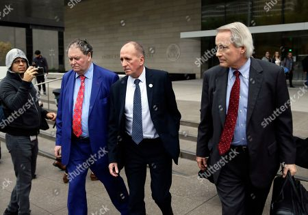 """Mark Stephen, Vernon Unsworth, L. Lin Wood. British cave explorer Vernon Unsworth, center, with his attorneys, Mark Stephens, second from left, and Lin Wood, right, walk out of Los Angeles U.S. District Court. A Los Angeles jury has found Elon Musk did not defame Unsworth when he called him """"pedo guy"""" in an angry tweet. Unsworth, who participated in the rescue of 12 boys and their soccer coach trapped for weeks in a Thailand cave last year, had angered the Tesla CEO by belittling his effort to help with the rescue as a """"PR stunt"""