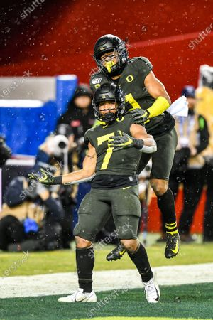 Oregon Ducks wide receiver Johnny Johnson III (3) leaps on Oregon Ducks running back CJ Verdell (7) to celebrate his touch down during the PAC-12 Football Championship game between the Utah Utes and the Oregon Ducks at Leviâ€s Stadium in Santa Clara, California