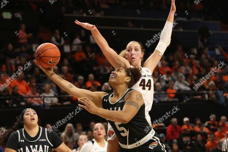 Hawaii's Myrrah Joseph (5) gets around Oregon State's Taylor Jones (44) during the second half of an NCAA college basketball game in Corvallis, Ore., . Oregon State won 64-32