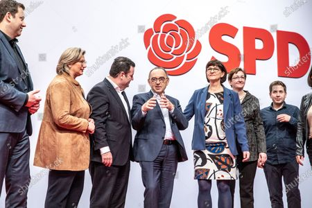 Stock Photo of (L-R) Social Democratic Party (SPD) Secretary General Lars Klingbeil, SPD Chairwoman in Saarland and deputy federal board chair Anke Rehlinger, German Minister of Labor and Social Affairs and deputy federal board chair Hubertus Heil,   Social Democratic Party (SPD) co-chairs Norbert Walter-Borjans and Saskia Esken, SPD Chairwoman in Schleswig-Holstein and deputy federal board chair Serpil Midyatli, Member of the Landtag Brandenburg of the German Social Democratic Party (SPD) and deputy federal board chair Klara Geywitz, Social Democratic Party (SPD) youth organization Jusos chairman and deputy federal board chair Kevin Kuehner, The Social Democratic Party (SPD) treasurer Dietmar Nietan during the Social Democratic Party (SPD) Party Convention at CityCube in Berlin, Germany, 07 December 2019. The SPD party members gather in the German capital from 06 to 08 December and vote for the new party leadership.
