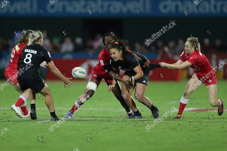 New Zealand's Shakira Baker passes the ball in the final match against Canada at the Emirates Airline Rugby Sevens in Dubai, United Arab Emirates, Saturday, Dec.7, 2019