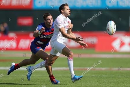 England's Ollie Lindsay-Hague, right, passes the ball during a quarter final match against France at the Emirates Airline Rugby Sevens in Dubai, United Arab Emirates