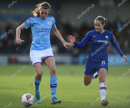 Jill Scott of Manchester City Women holds off Guro Reiten of Chelsea Women