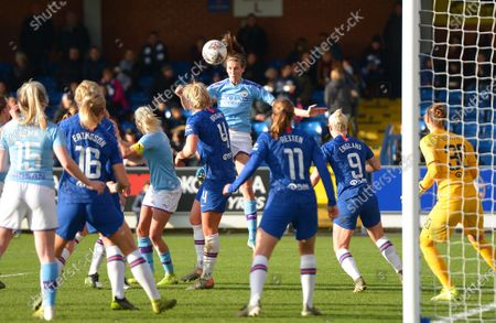 Jill Scott of Manchester City Women headers the ball back in to the centre of the box from a corner