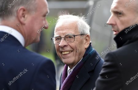 Stock Photo of Owner of Stoke City Peter Coates greets Manager Michael O'Neill of Stoke City as he gets off the coach
