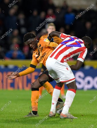 Leo Da Silva Lopes of Hull City and Badou Ndiaye of Stoke City
