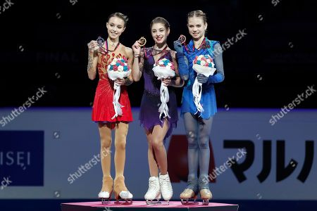 Russia's Alina Zagitova, center, winner of the women's free skating program, celebrates on the podium with second placed Russia's Anna Shcherbakova, left, and third placed Russia's Alexandra Trusova during the figure skating Grand Prix finals at the Palavela ice arena, in Turin, Italy