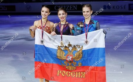 Russia's Alina Zagitova, center, winner of the women's free skating program, celebrates with second placed Russia's Anna Shcherbakova, left, and third placed Russia's Alexandra Trusova during the figure skating Grand Prix finals at the Palavela ice arena, in Turin, Italy