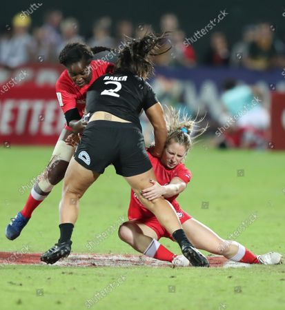 Shakira Baker (C) of New Zealand is tackled by Kayla Moleschi (R) of Canada during the HSBC World Rugby Sevens Series women final match between Canada vs New Zealand in Dubai, United Arab Emirates, 07 December 2019.