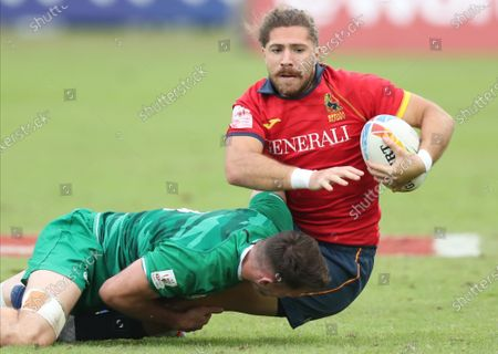 Inaki Nateu (R) of Spain is tackled by Jack Kelly (L) of Ireland during the HSBC World Rugby Sevens Series match between Ireland and Spain in Dubai, United Arab Emirates, 07 December 2019.