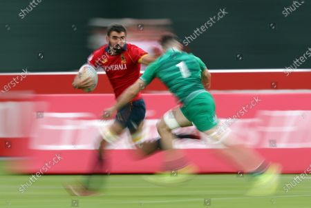 Javier Carrion (L) of Spain and Jack Kelly (L) of Ireland in action during the HSBC World Rugby Sevens Series match between Ireland and Spain in Dubai, United Arab Emirates, 07 December 2019.