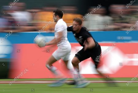 Stock Picture of Ollie Lindsay-Hague (L) of England in action  during the HSBC World Rugby Sevens Series match between England and New Zealand in Dubai, United Arab Emirates, 07 December 2019.