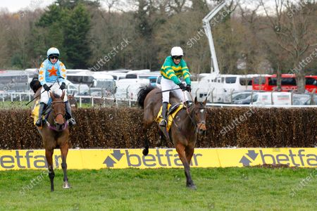 Stock Photo of Defi Du Seuil and Barry Geraghty [right] win the Betfair Tingle Creek Chase at Sandown from Un De Sceaux.