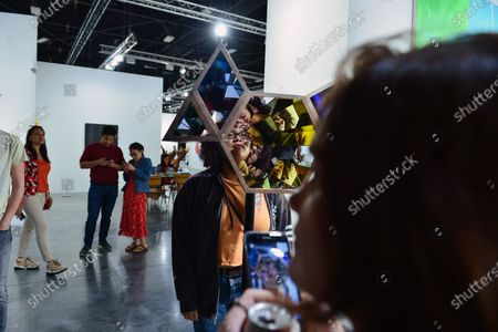 "Art Basel patrons look at works by Olafur Eliasson ""Your Vanishing"""